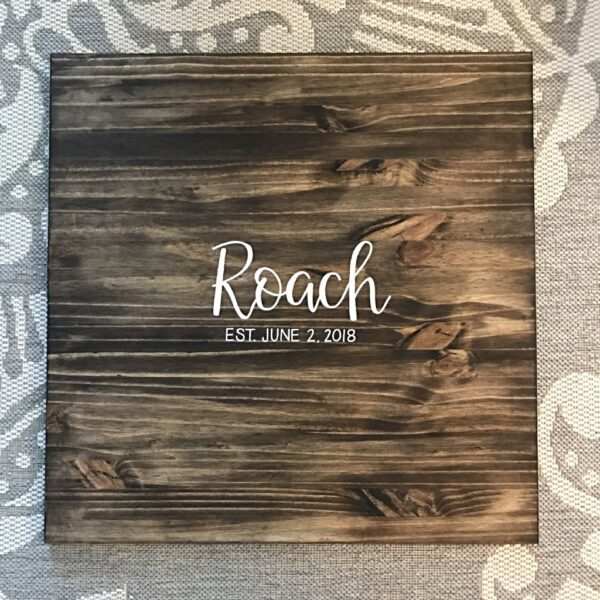 custom guest book with paint on wood with lsatname in Indianapolis