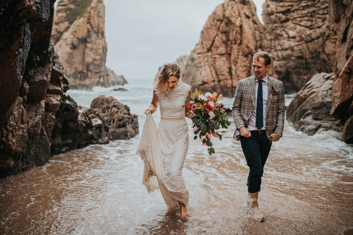 bride carrying a bouquet of flowers in a high neck wedding dress | micro-wedding vs. elopement