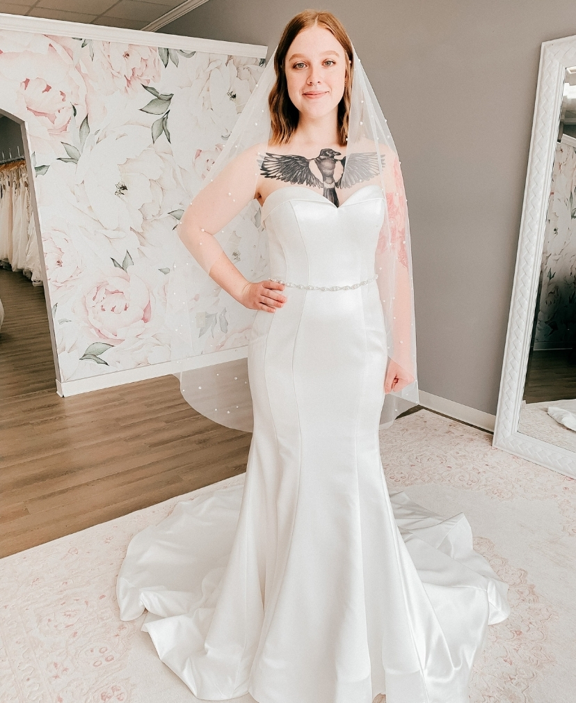 simple fitted satin wedding dress with a pearl veil
