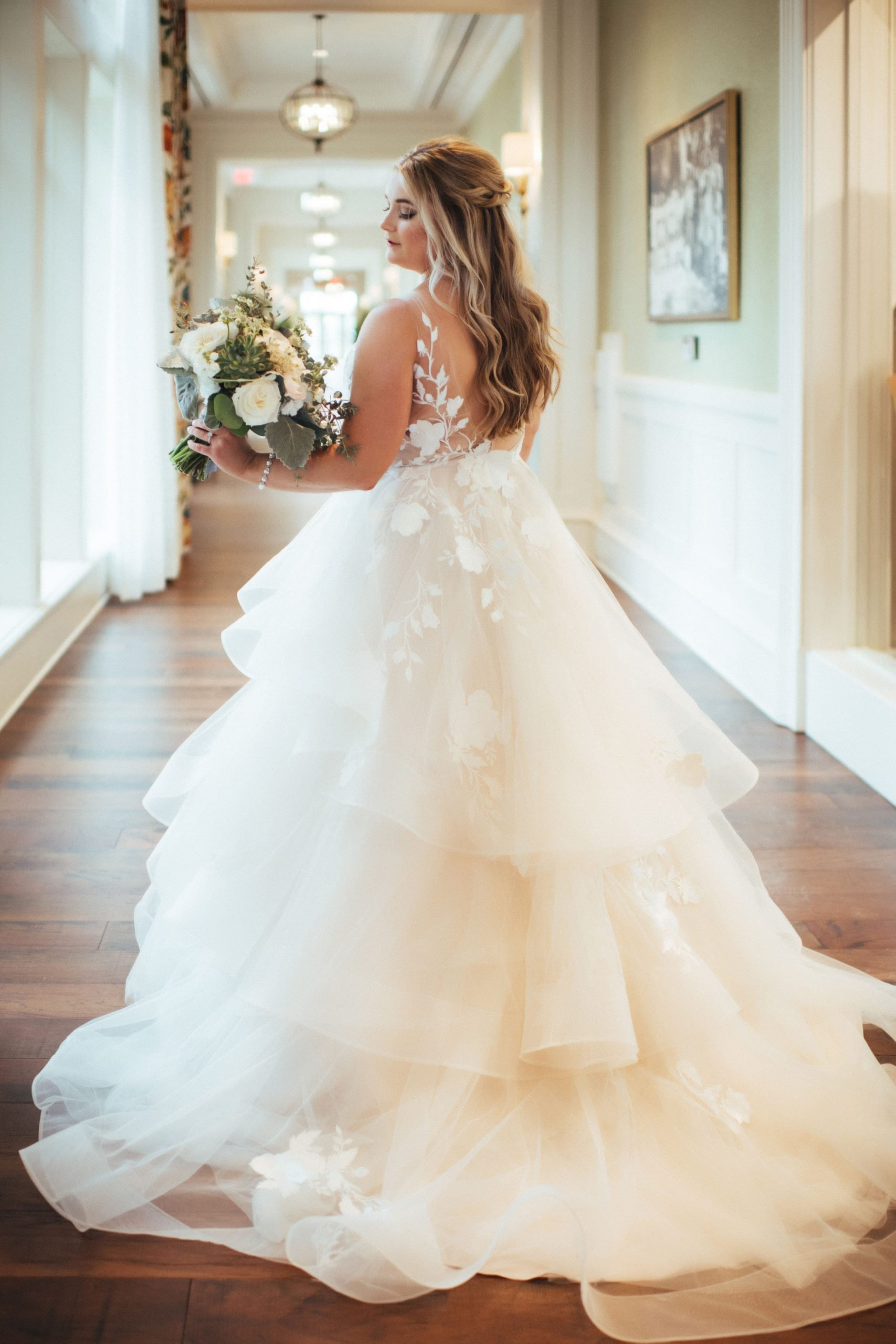 Ballgown tiered skirt with horsehair trim and lace appliques from Sophia's Bridal