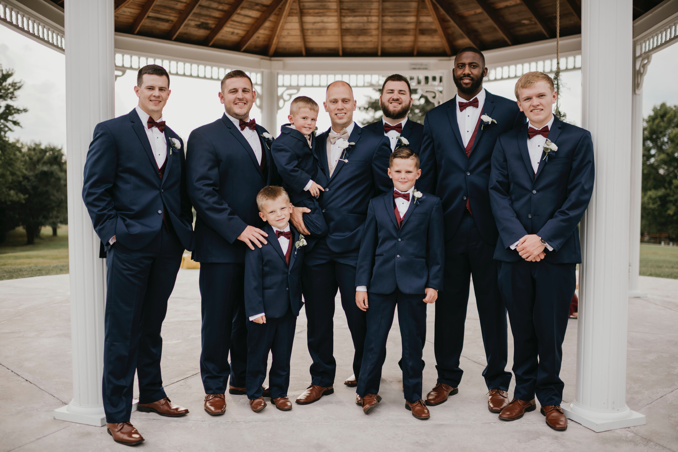wedding party groomsmen and groom in tuxes at wedding