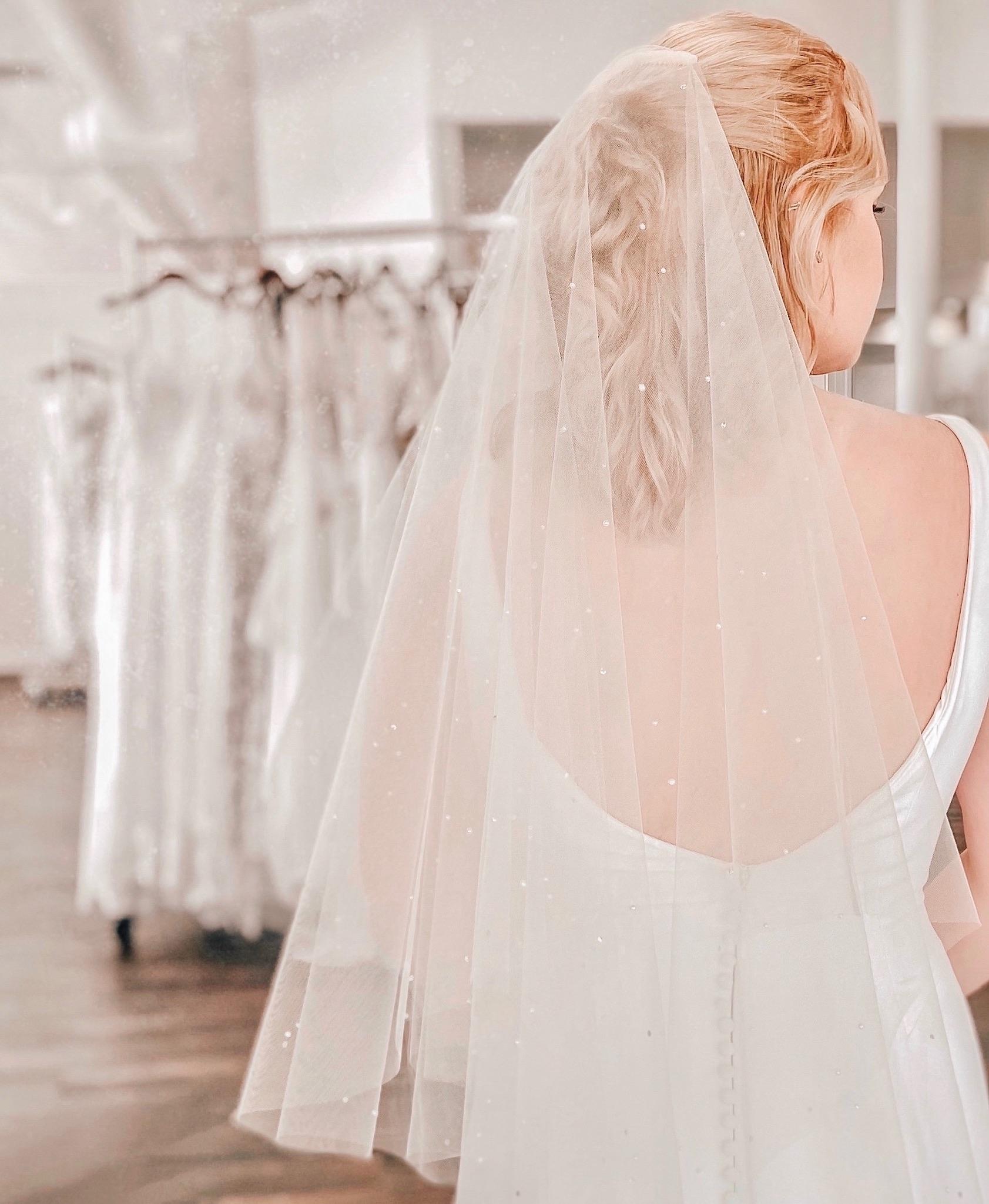 pearl veil on a wedding dress