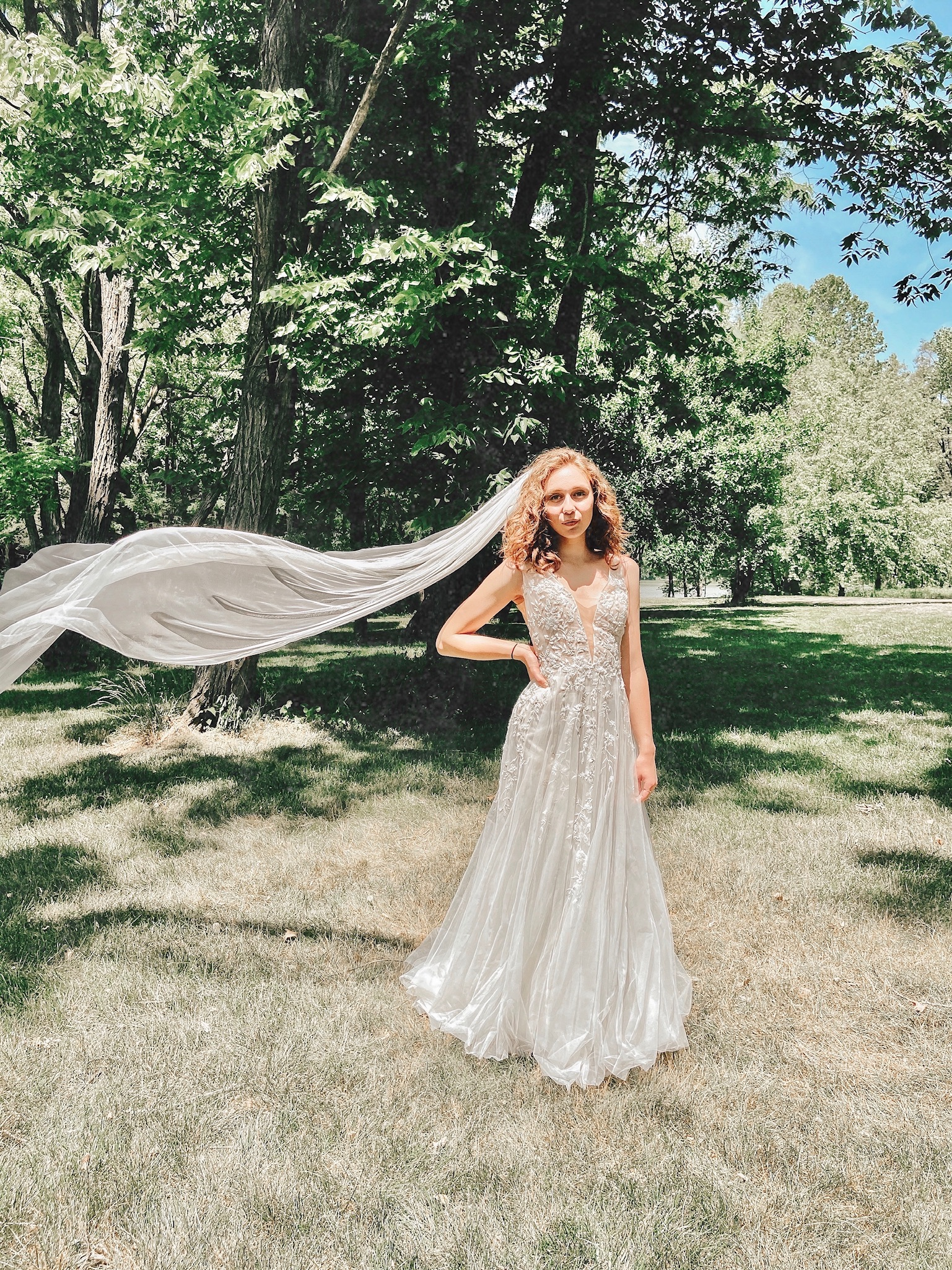 wedding photos at the Indianapolis Museum of Art with a veil flowing in the wind