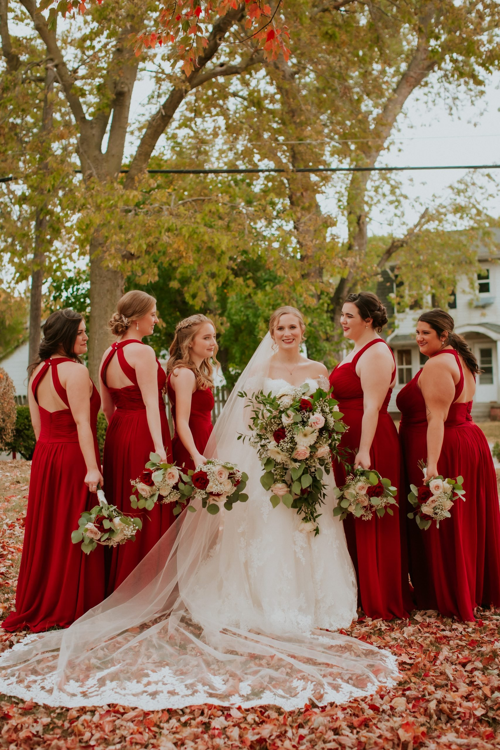 bride and red bridesmaids dresses with key hole back