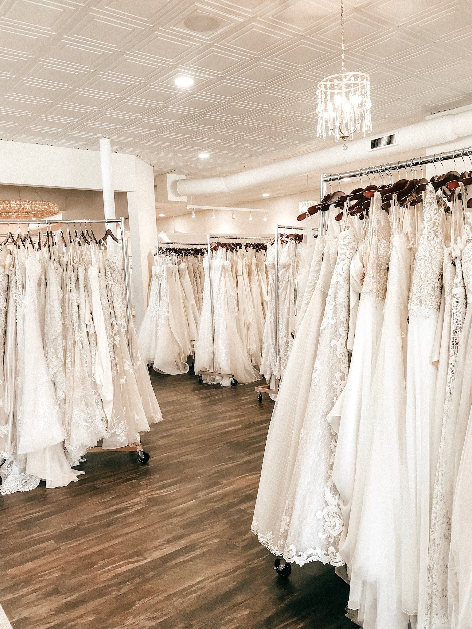 room full of wedding dresses ready for a sample sale at an Indianapolis bridal boutique