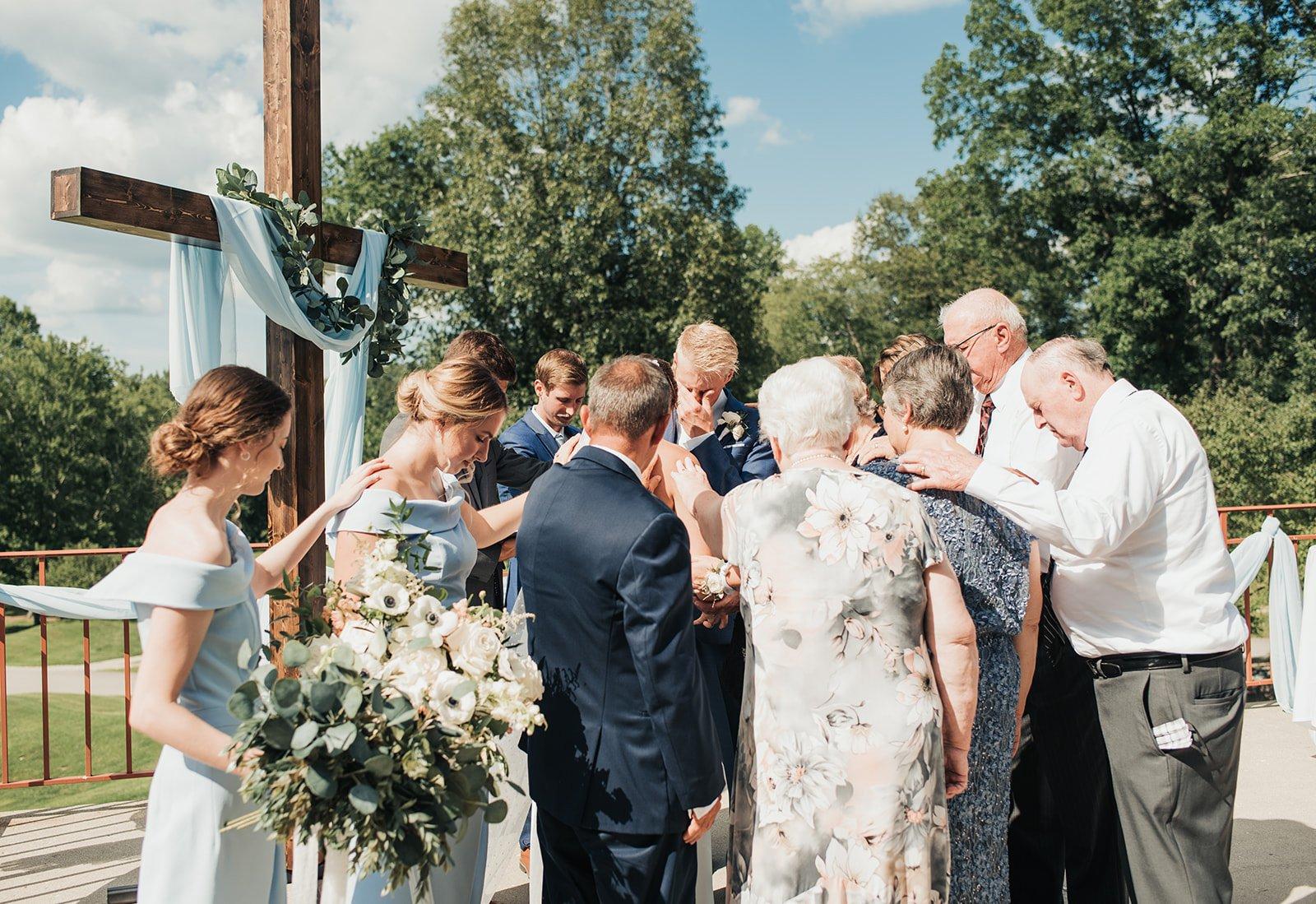 praying at a wedding