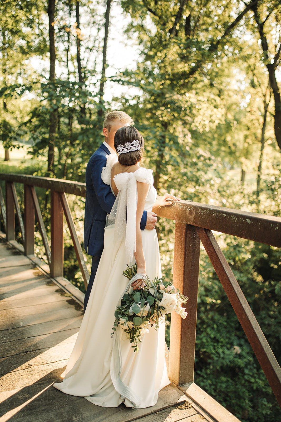 bride in her wedding dress with details