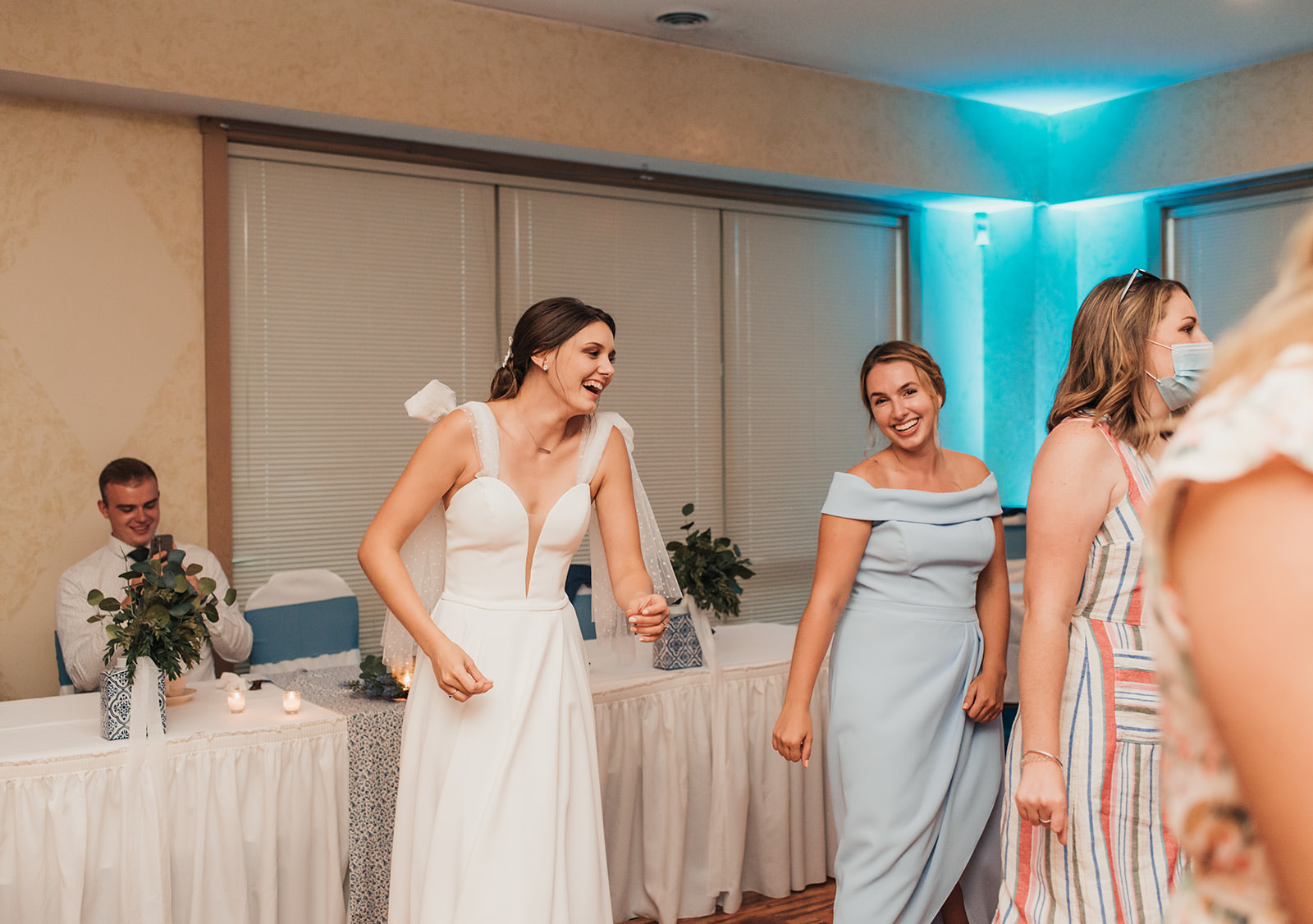 bridal party dancing at a wedding in the bridesmaid dresses with the bride