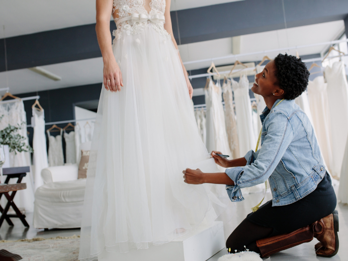 girl getting her wedding dress alterations done