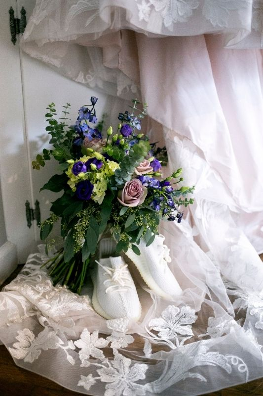 brides shoes and flower bouquet on her wedding day