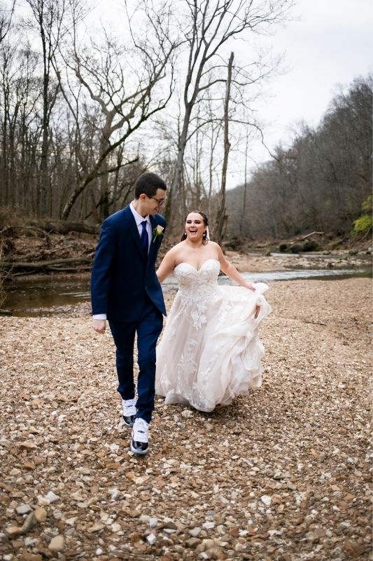 bride and groom running together on their wedding day