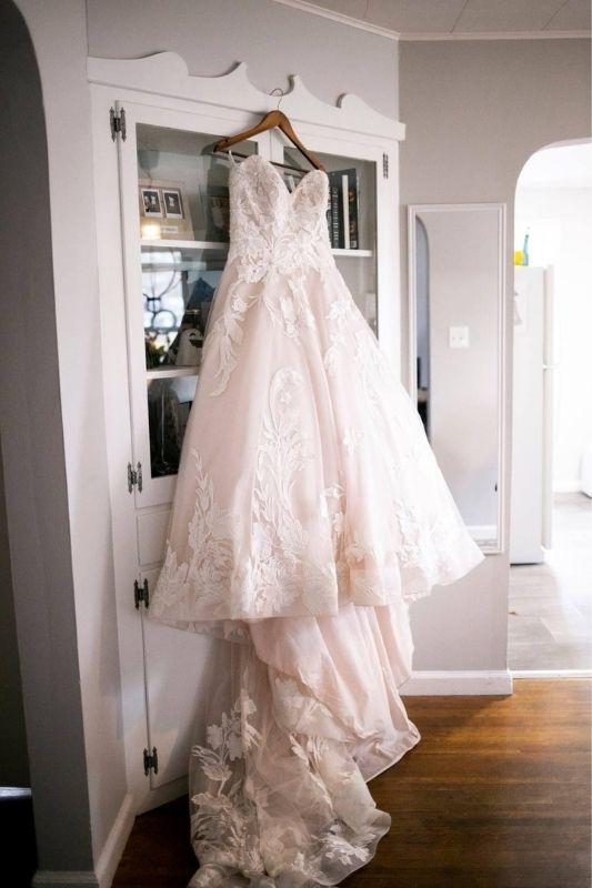 wedding dress hanging in venue