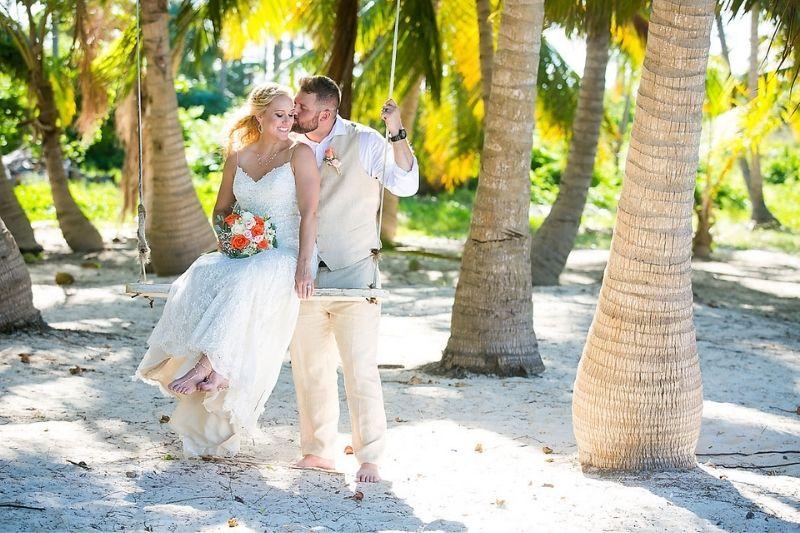 beach wedding vibes with tan groom attire