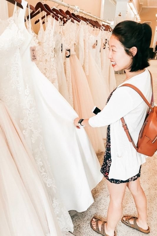 bride looking through dresses to find her perfect one