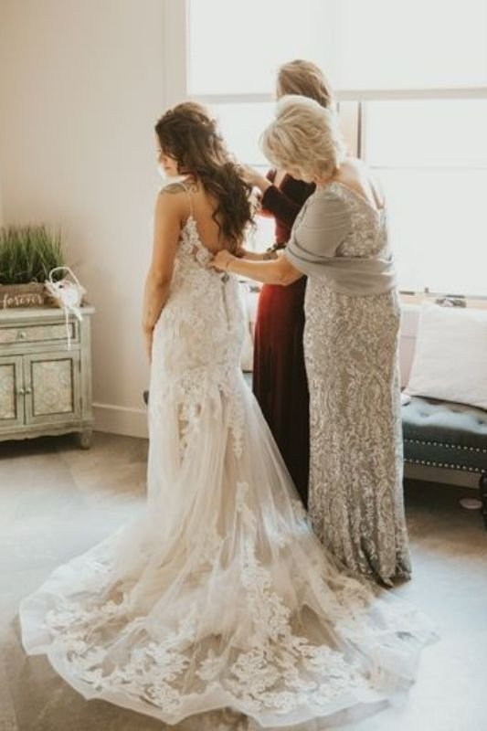 a girl in her wedding dress on her wedding day
