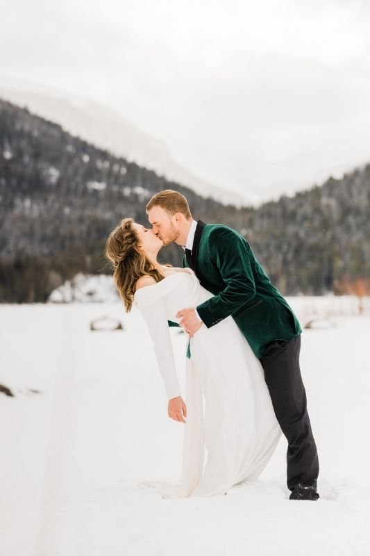 winter wedding season and the groom is in a green velvet tux