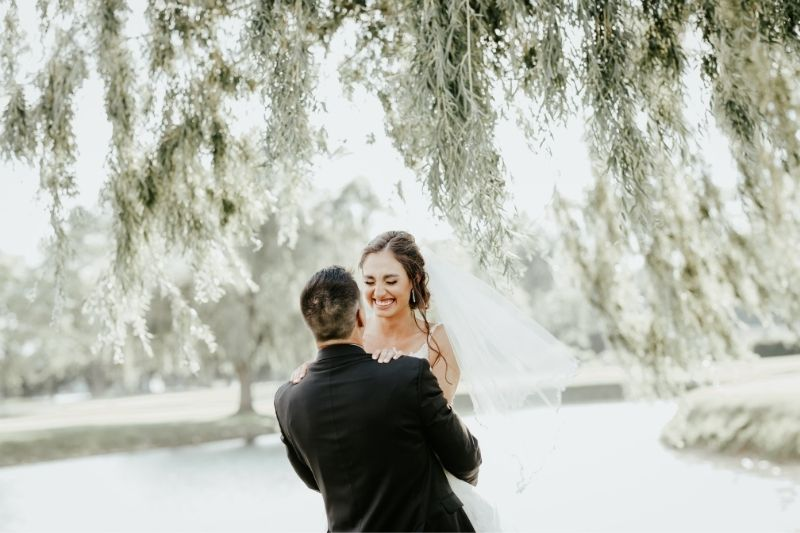 bride and groom laughing wedding day photography