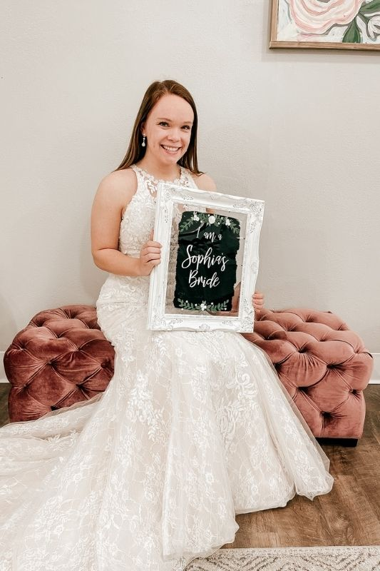 a bride saying yes to the dress at a bridal boutique
