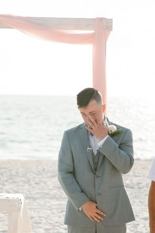 groom crying on his wedding day when wife walks down the aisle