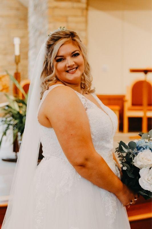 Bride on her wedding day in her wedding dress