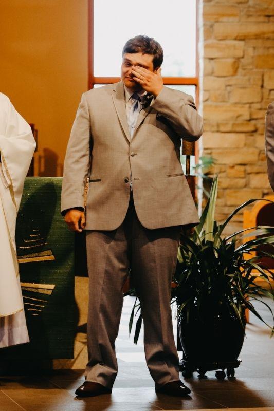 groom crying on wedding day