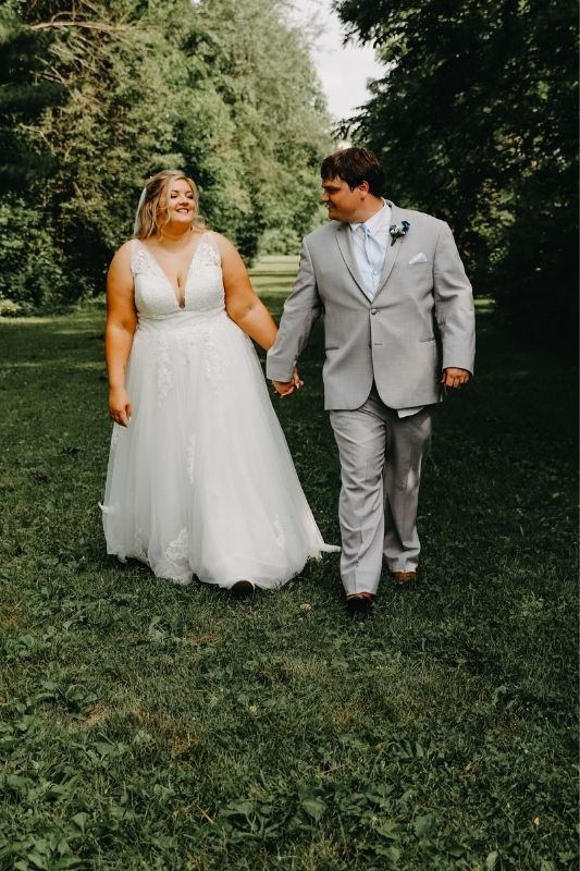 bride and groom walking on their wedding day