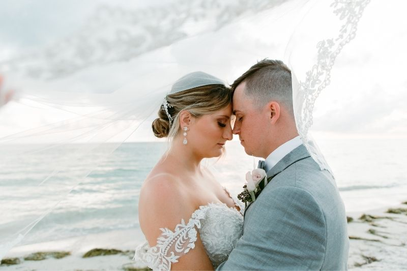 beach photos of bride and groom