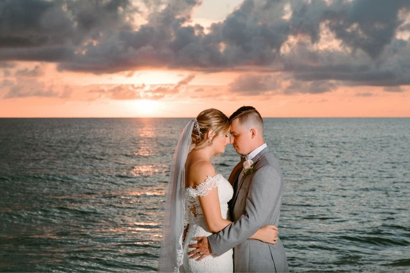 sunset photos on the bride and grooms wedding day