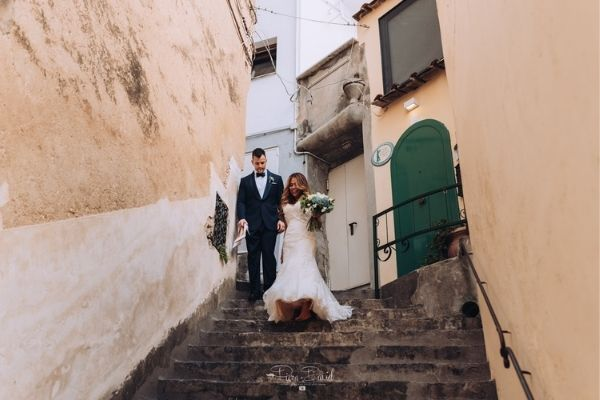 walking down the stairs on wedding day